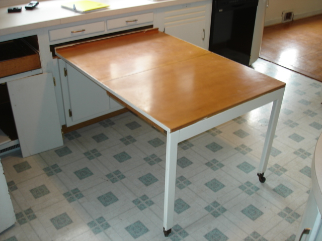 Kitchen cabinets with a built-in table